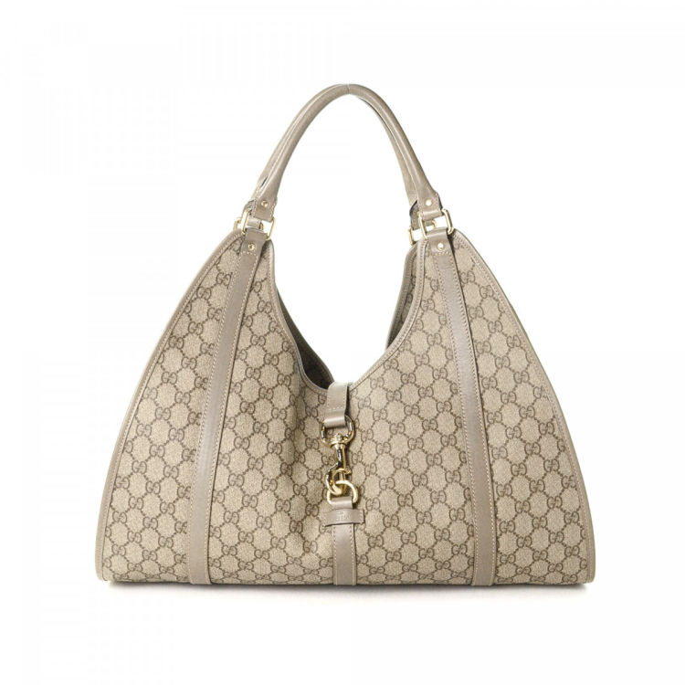 39f7853ae225 LXRandCo guarantees this is an authentic vintage Gucci Bardot shoulder bag.  This signature shoulder bag was crafted in gg supreme coated canvas in  beautiful ...