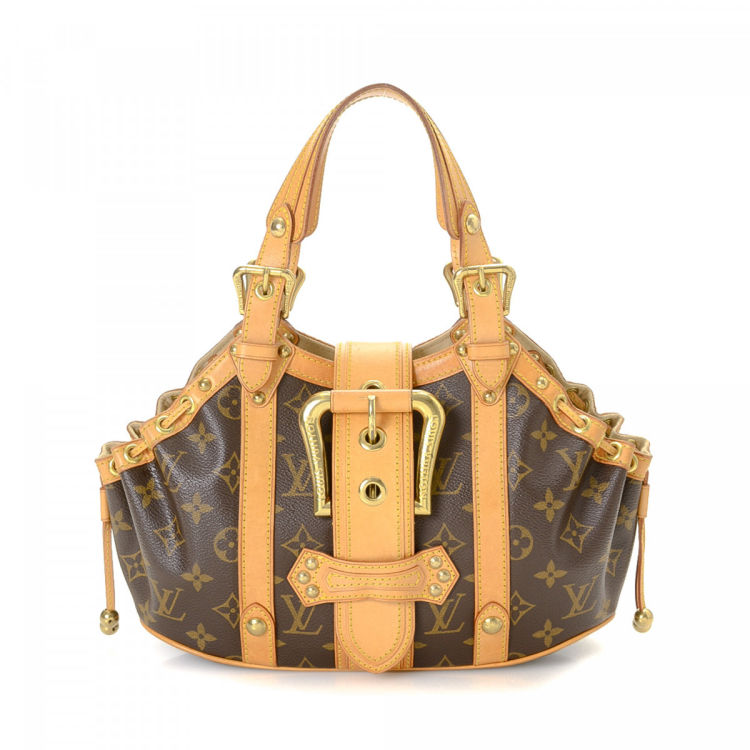 38319b839d87 LXRandCo guarantees this is an authentic vintage Louis Vuitton Theda PM  handbag. Crafted in monogram coated canvas