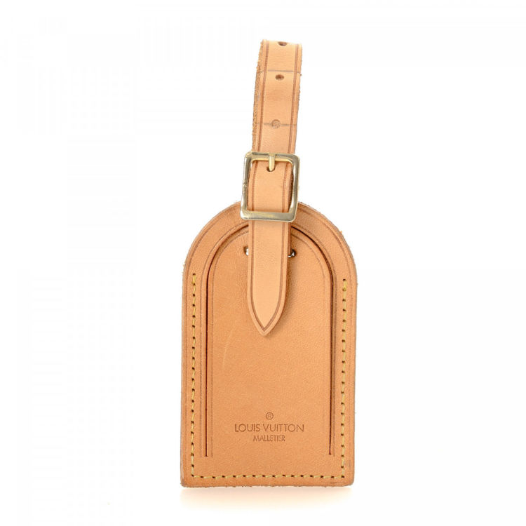 7cc6ebdc5b85 LXRandCo guarantees this is an authentic vintage Louis Vuitton Luggage Tag  accessory. This exquisite accessory in beige is made of natural cowhide  leather.