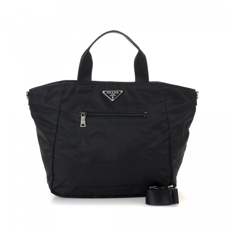 65288e714bf1 The authenticity of this vintage Prada Two Way tote is guaranteed by  LXRandCo. This classic tote in beautiful black is made in tessuto nylon.