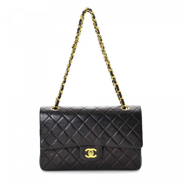 7edc453f596 LXRandCo guarantees this is an authentic vintage Chanel Medium Classic  Double Flap shoulder bag. This chic purse was crafted in lambskin in  beautiful black.